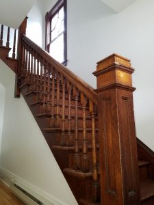 entryway stair way with wood rail